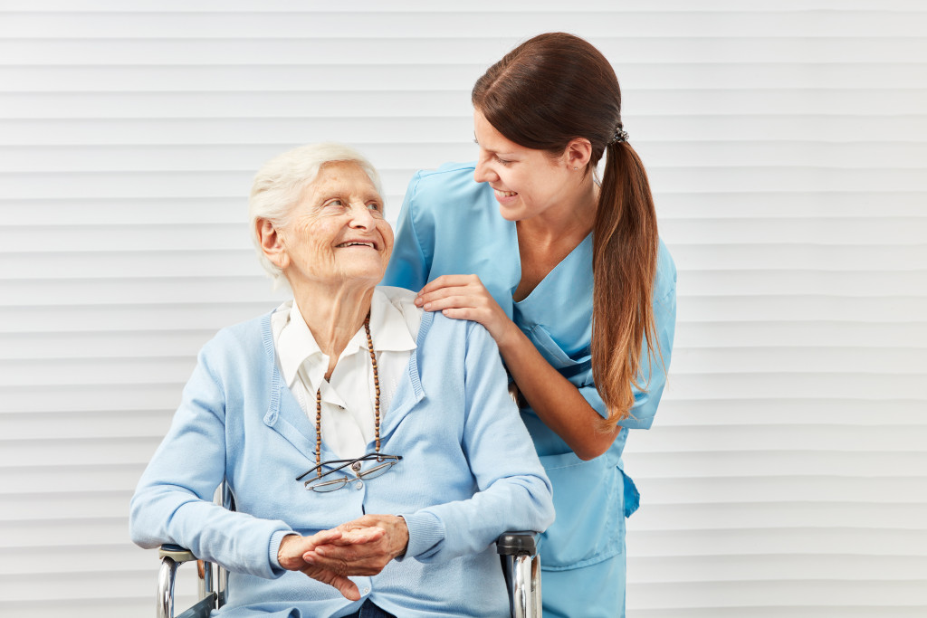 nurse assissting old woman