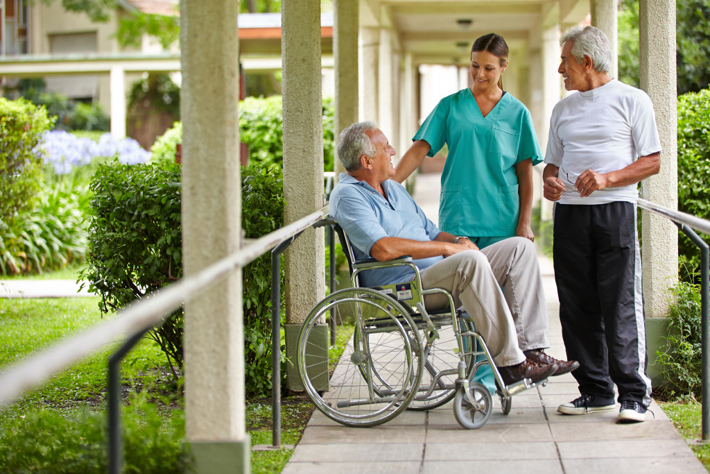 nurse assissting elderly
