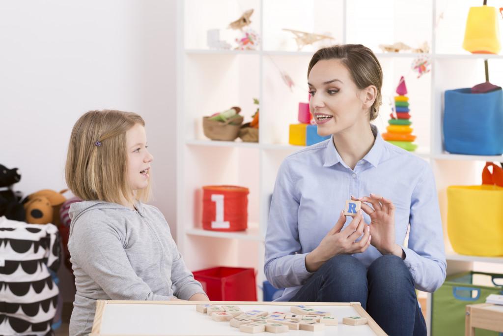 child talking to her teacher